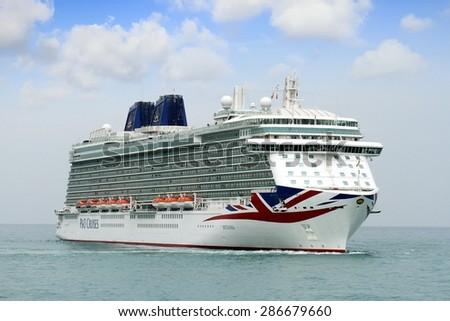 "ALICANTE, SPAIN   APRIL 22: The luxury cruise ""BRITANNIA"" of P&O Cruises Company entering in the port of Alicante; Spain; on april 22, 2015 in Alicante. - stock photo"