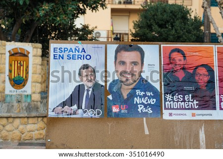 ALICANTE, SPAIN-DECEMBER 11, 2015: Political campaign posters depicting several presidential candidates on the kickoff to the 2015 elections. - stock photo
