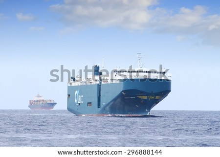 "ALICANTE, SPAIN â?? JULY 04: The cars transport ""ARABIAN BREEZE"" is is sailing in open waters full ahead close to the coast of Alicante; Spain; on july 04, 2015 in Alicante. - stock photo"