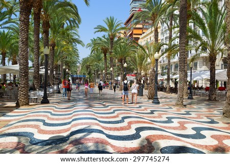 ALICANTE, SPAIN - July 6, 2015:  The promenade Explanada of Spain in Alicante is paved with 6.5 million marble floor tiles creating a wavy form and is one of the most lovely promenades in Spain.