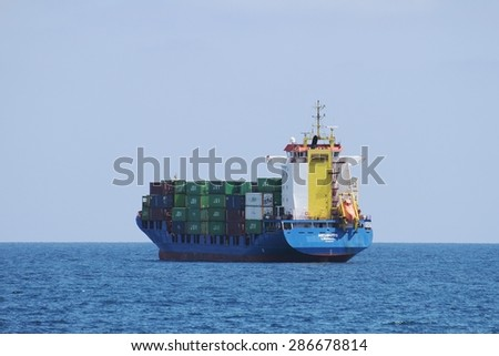 "ALICANTE, SPAIN   JUNE 02: The container ship ""NEUBURG"" waits anchored for entering in the port of Alicante; Spain; on JUNE 2, 2015 in Alicante. - stock photo"