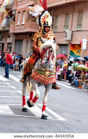 ALICANTE, SPAIN - JUNE 8: Unidentified participants at Fiesta Moros and Cristianos, costume parade on the streets of Alicante, June 8, 2008, Alicante, Spain