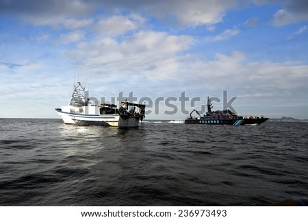 ALICANTE, SPAIN - MAY 16: A coastguard of the Spanish Customs Service makes its patrol along the coast of Altea and Calpe in the Mediterranean province of Alicante, on may 16, 2014 in Alicante.