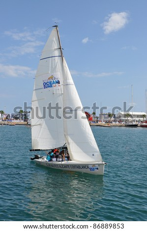 ALICANTE, SPAIN - OCT 16: Tourists experiencing a ride in a sail boat at the 2011-2012 Volvo Ocean Race village event in the harbor of Alicante, Oct 16, 2011.