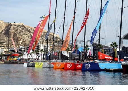 ALICANTE, SPAIN - OCTOBER 03 th: The Volvo Open 65 class sailboats are docked before  the training day in Alicante bay, on october 03 th, 2014 in Alicante. - stock photo