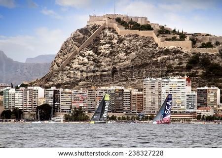 ALICANTE, SPAIN - OCTOBER 02th: Volvo Open 65 sailboats in regatta race, training day for the Open 65 sailboat class in Alicante bay, on October 02th, 2014 in Alicante. - stock photo