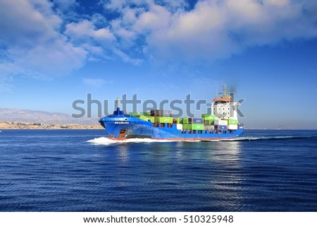 ALICANTE, SPAIN - OCTOBER  21: The container ship NEUBURG sailing in course to the port of Alicante for download his containers, on october 21, 2016 in Alicante.