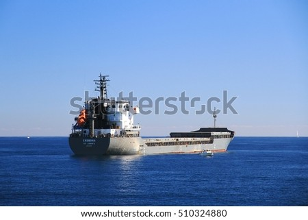 ALICANTE, SPAIN - OCTOBER 21. The general cargo ship CREMONA waiting anchored in Alicante Bay for enter to the port, on october 21, 2016 in Alicante.