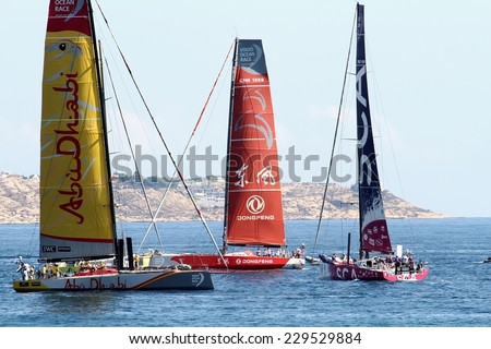 ALICANTE, SPAIN - OCTOBER 2: Volvo Open 65 embarcations in regatta race, training day for the Open 65 sailboat class in Alicante bay, on october 2, 2014 in Alicante.