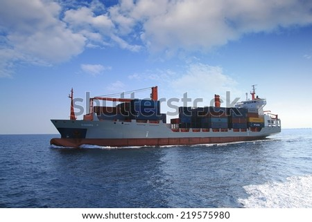 "ALICANTE, SPAIN - SEPTEMBER  20: The container ship ""BARBARA P"" after leaving the port of Alicante is sailing in open waters, on september 20, 2014 in Alicante."