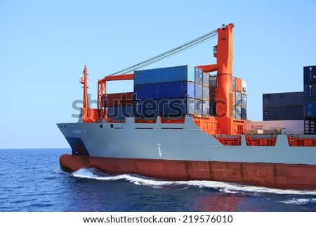 """ALICANTE, SPAIN - SEPTEMBER  20: The container ship """"BARBARA P"""" after leaving the port of Alicante is sailing in open waters, on september 20, 2014 in Alicante. - stock photo"""