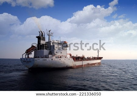 "ALICANTE, SPAIN - SEPTEMBER 22: The wine tanker transport ""Wine Trader""  is sailing close to the port of Alicante, on september 22, 2014 in Alicante."