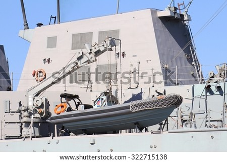 ALICANTE, SPAIN - SEPTEMBER 19: Zodiac and details of the destroyer F-104 MENDEZ NUÃ?EZ of the Spanish Navy docked in the port of Alicante in the Mediterranean Sea, on September 19, 2015 in Alicante. - stock photo