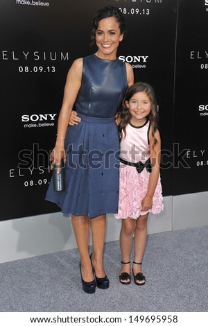 "Alice Braga & Emma Tremblay (right) at the world premiere of their movie ""Elysium"" at the Regency Village Theatre, Westwood. August 7, 2013  Los Angeles, CA - stock photo"