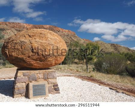 Alice Springs, Australia - 2015, June 30: The grave of John Flynn, the great outback developer, called Flynn's Grave and Mount Gillen in the back, Alice Springs - stock photo