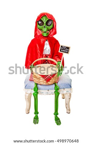 Alien dressed as Red Riding Hood, hoping to be taken to the leader.  Shot on white background.