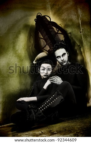 Alien monster mother and daughter portrait in alien world. - stock photo