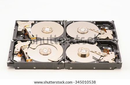 aligned group of computer hard drives - stock photo