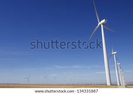 aligned group of windmills for renewable electric energy production