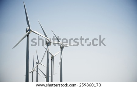 aligned group of windmills for renewable electric energy production, Navarre, Spain - stock photo