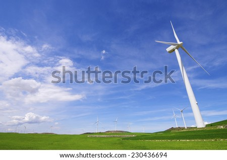 aligned group of windmills for renewable electric energy production, Zaragoza province, aragon, Spain - stock photo