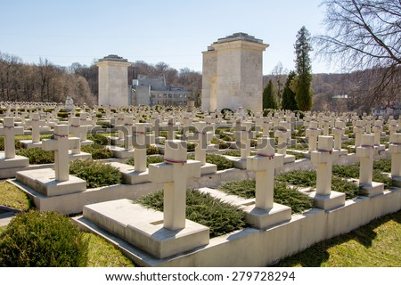 Aligned headstones in a cemetery in the foreground. Cemetery in Autumn or Summer, spring - stock photo