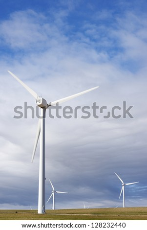 aligned windmills for renewable electric energy production - stock photo