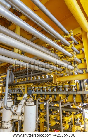 Aligned X-mass tree, Control valve and Flow line for oil and gas production process, Pipeline construction on offshore wellhead remote platform, Energy and petroleum industry. (Vertical) - stock photo