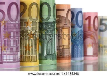 All Euro notes of the European Union Currency in a row with reflection - stock photo