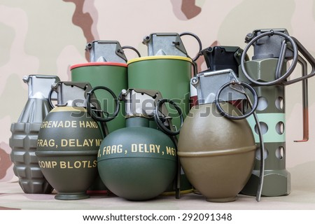 All explosives, weapon army,standard time fuze, hand grenade on camouflage background - stock photo
