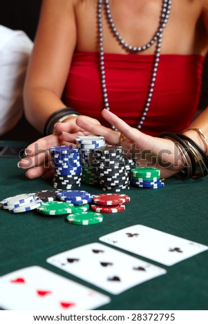 All In. People playing cards, chips and players gambling around a green felt poker table. Shallow Depth of field - stock photo