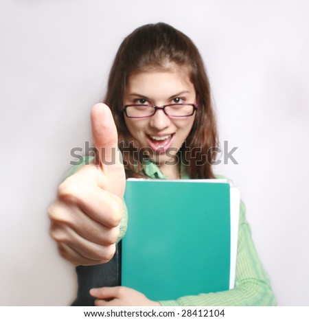 All is excellent. Portrait of the girl with the hand extended forward and lifted upwards thumb.