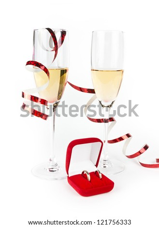 All lovers champagne glasses with wedding rings