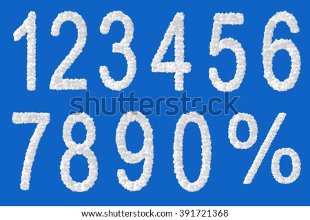 All numbers and percent made from clouds on blue background - stock photo