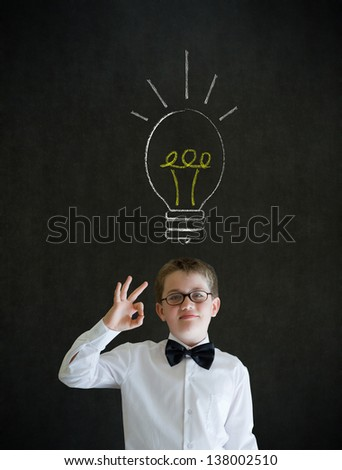 All ok or okay sign boy dressed up as business man with bright idea chalk background lightbulb on blackboard background - stock photo