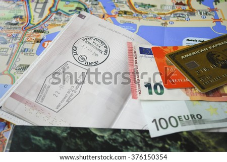 All that need for travel: passport, in cash, credit cards, maps. - stock photo