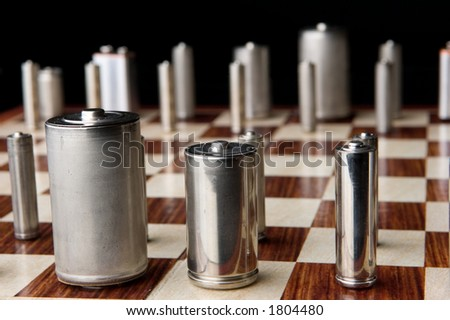 All the common battery types line up on the chess board in this conceptual image which speaks to geopolitical maneuvering over energy policy.