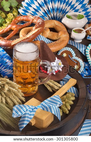 All typical German Bavarian symbols in one picture. Gingerbread heart, soft pretzels, Bavarian veal sausage and beer. - stock photo