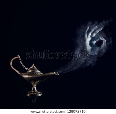 All will be done, my lord. Magic Aladdin lamp with smoky genie hand - stock photo