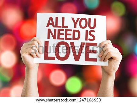 All You Need is Love card with colorful background with defocused lights - stock photo