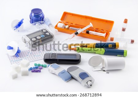 All you need to control diabetes: - insulin pump for continuous feed -blood sugar meter - insulin pen - grucose injection (adrenalin)  - sugar (carbohydrate) - health food - stock photo