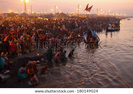 Allahabad, India - February 10, 2013: Hindu devotees came to confluence of the Ganges and the Yamuna River for holy dip during the festival Kumbh Mela. It is the world's largest religious gathering - stock photo