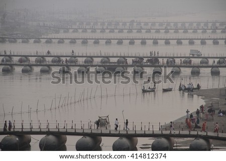 ALLAHABAD, INDIA - FEBRUARY 02, 2013: Thousands of Hindu devotees come to confluence of the Ganges and Yamuna River for holy dip during the festival Kumbh Mela. The world's largest religious gathering