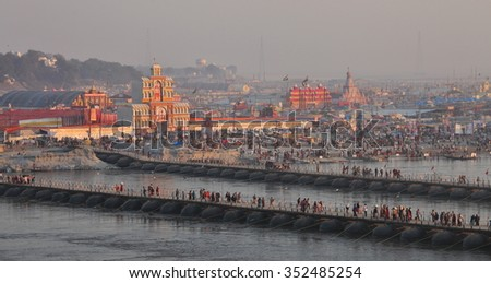 ALLAHABAD, INDIA - FEBRUARY 08, 2013: Thousands of Hindu devotees crossing the pontoon bridges over the Ganges River at Maha Kumbh Mela festival in Allahabad, India. - stock photo