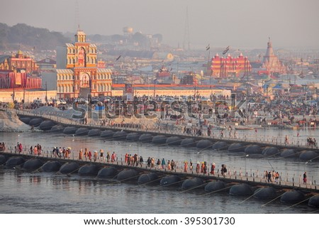 ALLAHABAD, INDIA - FEBRUARY 08, 2013: Thousands of Hindu devotees crossing the pontoon bridges over the Ganges River at Maha Kumbh Mela festival in Allahabad, India - stock photo