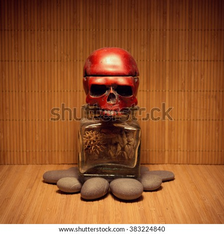 Allegory tomb monument with skull head and dry floral parts as internal organs inside of a jar - stock photo