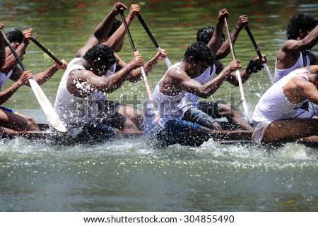 ALLEPPEY, INDIA - AUG 08 : Unidentified oarsmen in a snake boat team compete in the most popular Nehru Trophy Boat race held in August 08, 2015 in Alleppey,Kerala, India - stock photo