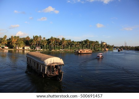 ALLEPPEY, INDIA -OCT 09 : A house boat transports tourists around the backwaters on October 09, 2016 in Alleppey, India. House boat cruise is the top attraction of the inbound tourism in Kerala.