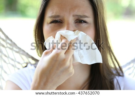 Allergic girl with a tissue
