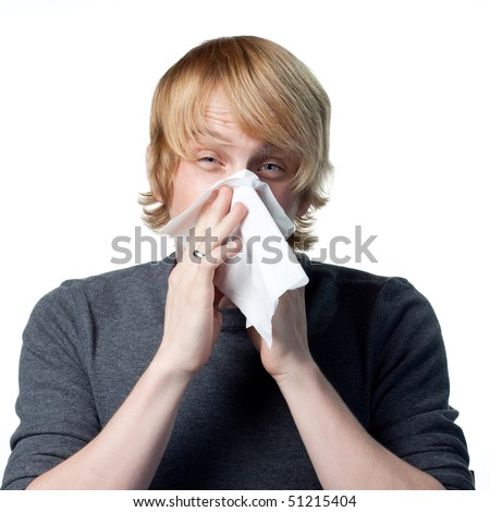 Allergic reactions for this man blowing his nose